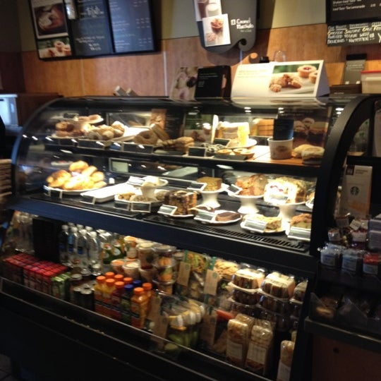 Photo taken at Starbucks by Lu A. on 3/11/2012
