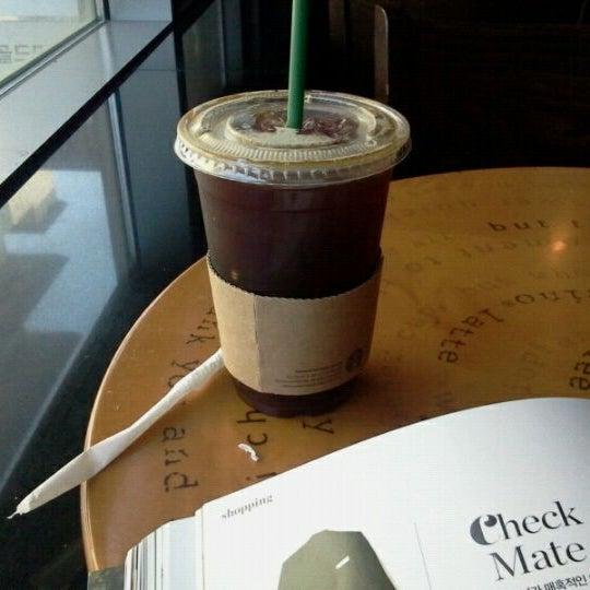 Photo taken at Starbucks by Angie K. on 5/4/2012