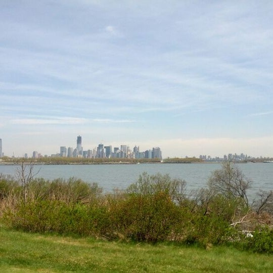 Photo taken at Liberty National Golf Course by Khee L. on 4/14/2012