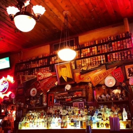 Photo taken at Manuel's Tavern by Samantha J. on 8/14/2012
