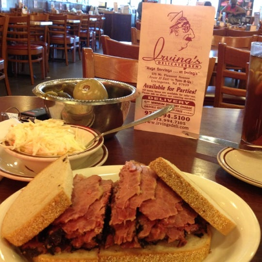 Photo taken at Irving's Delicatessen by Troy T. on 3/19/2012
