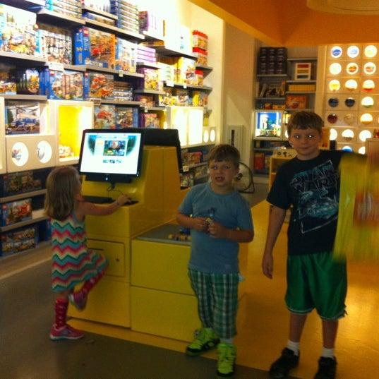 Photo taken at The LEGO Store by Christina B. on 8/4/2012