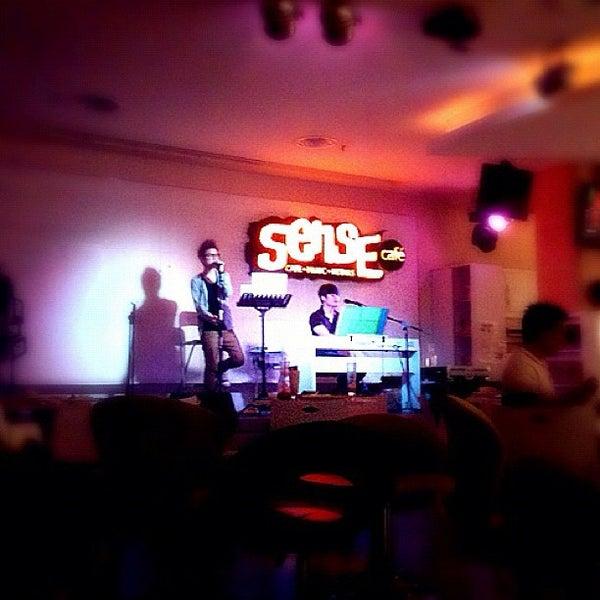 Photo taken at Sense Cafe by Nick C. on 2/14/2012