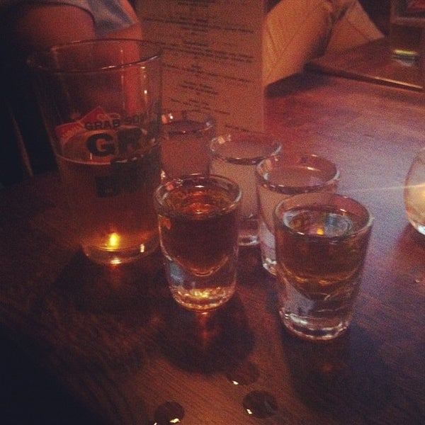 Photo taken at Double Wide Bar & Southern Kitchen by Andrew M. on 6/8/2012