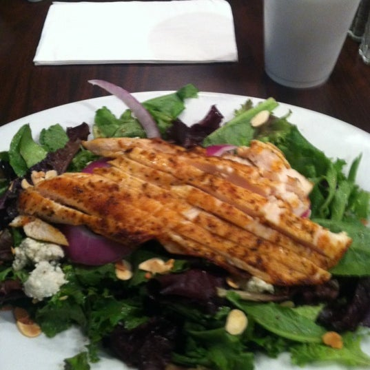 Photo taken at Village Bread Cafe by Mike C. on 6/4/2012