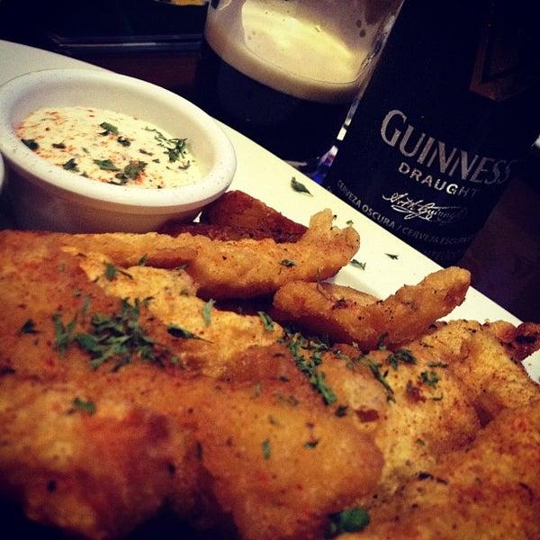 Photo taken at Dublin's Irish Pub by Alex R. on 3/12/2012