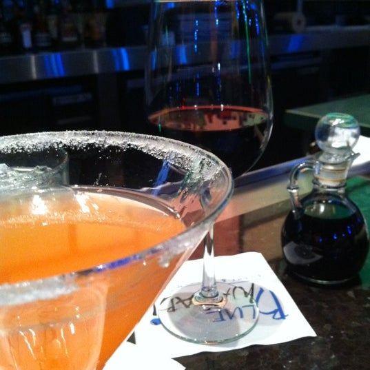 Photo taken at Blue Wasabi Sushi & Martini Bar by Terrii P. on 5/8/2012