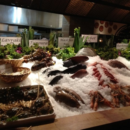 Photo taken at Kellari Taverna NY by Maxine B. on 6/22/2012