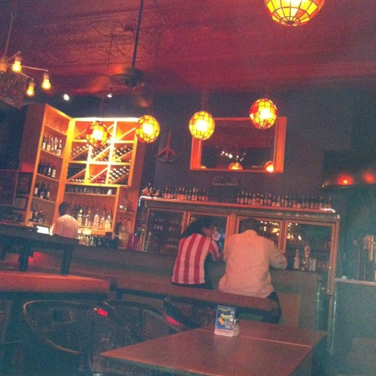 Photo taken at Pizza Lounge by Erin C. on 6/16/2012