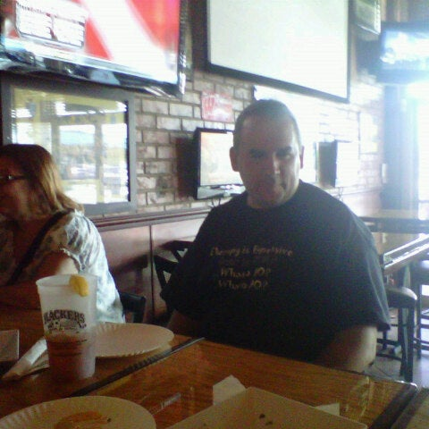 Photo taken at Slackers Bar & Grill by Jenny H. on 8/21/2012