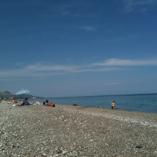 Photo taken at Spiaggia Di Fondachello by Morena P. on 4/29/2012