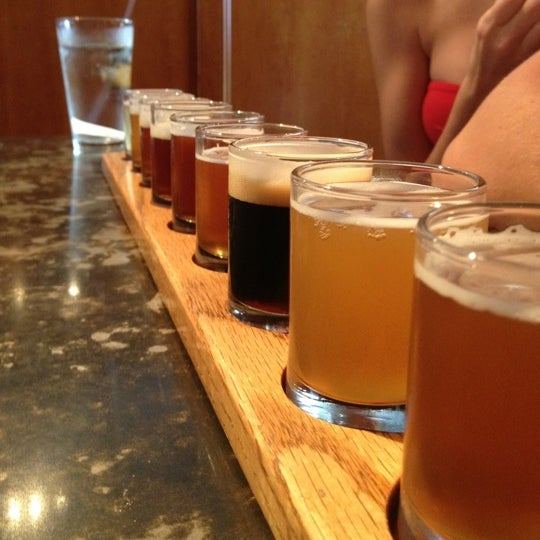 Photo taken at Portsmouth Brewery by Carrie M. on 8/26/2012