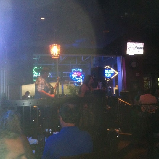 Photo taken at Dugan's Pub by Andrew M. on 6/30/2012