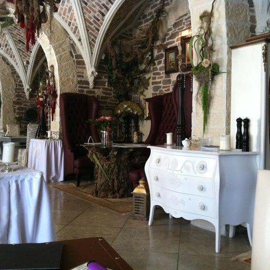 Photo taken at Chateau de Fleurs by Maria F. on 7/16/2012