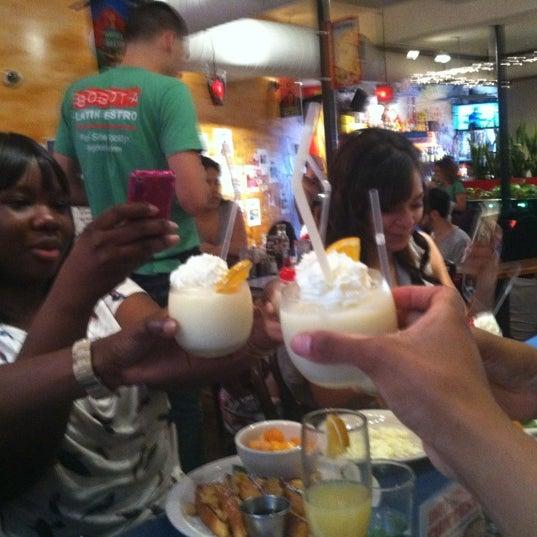 Photo taken at Bogota Latin Bistro by Christal K. on 5/27/2012
