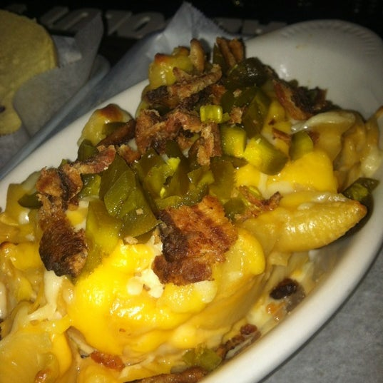 Photo taken at Double Wide Bar & Southern Kitchen by J R. on 4/25/2012