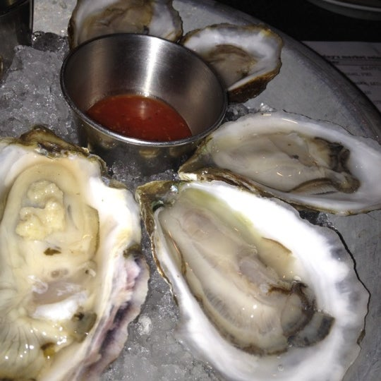 Photo taken at Upstate Craft Beer and Oyster Bar by Anthony P. on 3/13/2012