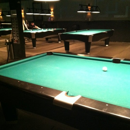 Photo taken at Pressure Billiards & Cafe by Rachael T. on 5/15/2012