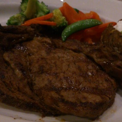 Photo taken at Outback Steakhouse by Hiram C. on 8/18/2012