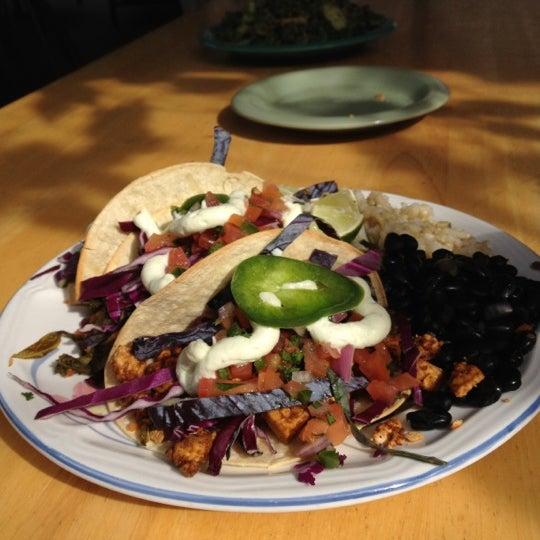 Photo taken at Sugar Plum Vegan Cafe by Ashley M. on 3/23/2012