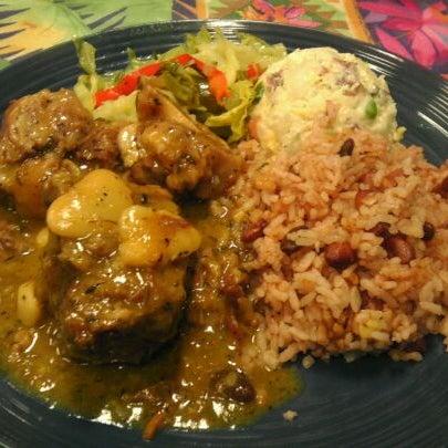 Photo taken at Mama Jamaica's Kitchen by Christine G. on 2/4/2012