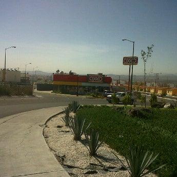 Photo taken at Oxxo La Pradera II by Mauricio C. on 4/25/2012