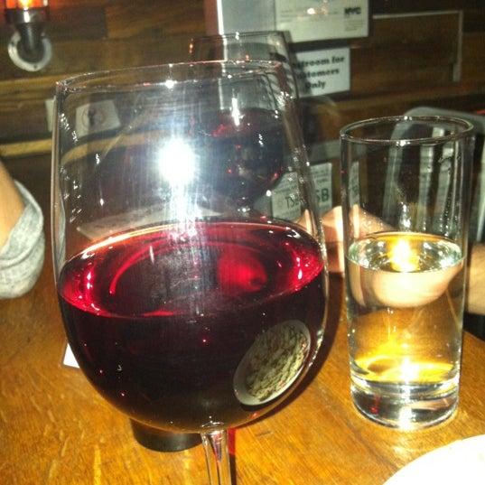Photo taken at Custom Wine Bar by Michael M. on 4/15/2012