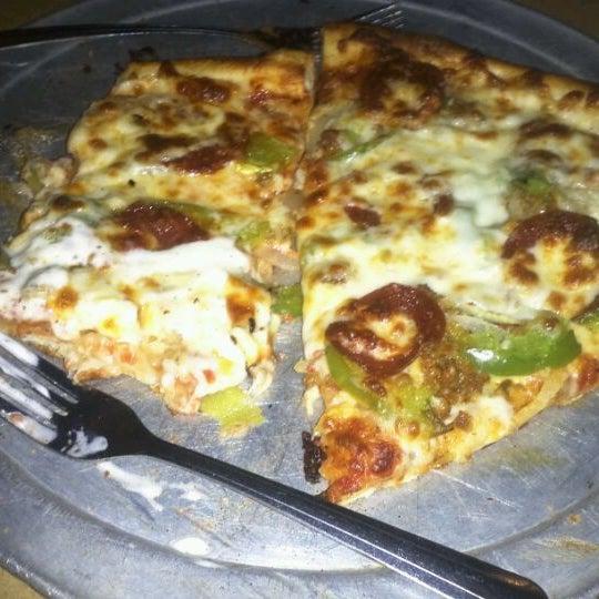 Photo taken at Stone Mountain Pizza Cafe by Dymond J. on 4/19/2012