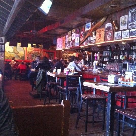 Photo taken at Dinosaur Bar-B-Que by Alexandra H. on 4/3/2012