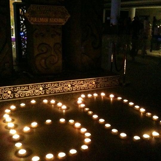 Photo taken at Pullman Kuching by Aaron K. on 3/31/2012