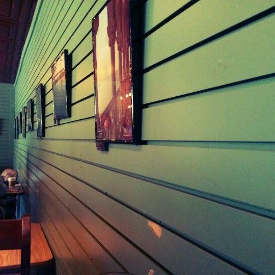 Photo taken at Bennu Coffee by Jin C. on 3/23/2012