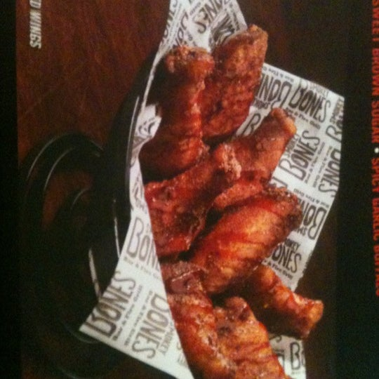 Photo taken at Smokey Bones Bar & Fire Grill by Brandy B. on 4/26/2012