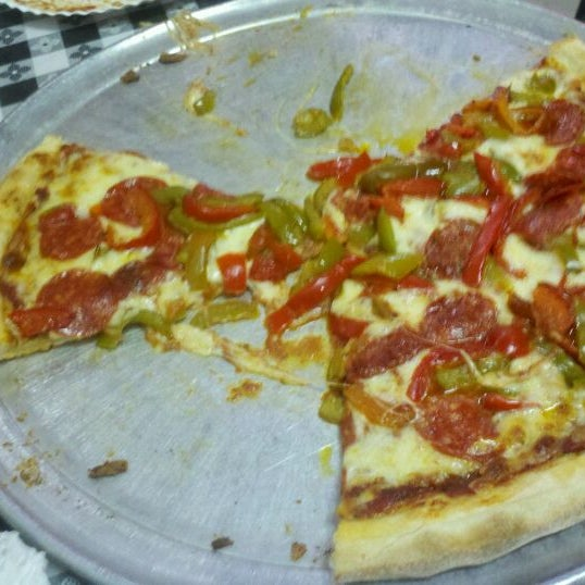 Photo taken at Rosa's Pizza by John G. on 5/3/2012