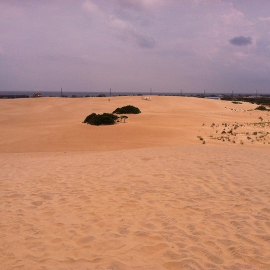 Photo taken at Jockey's Ridge State Park by Brittany L. on 7/10/2012