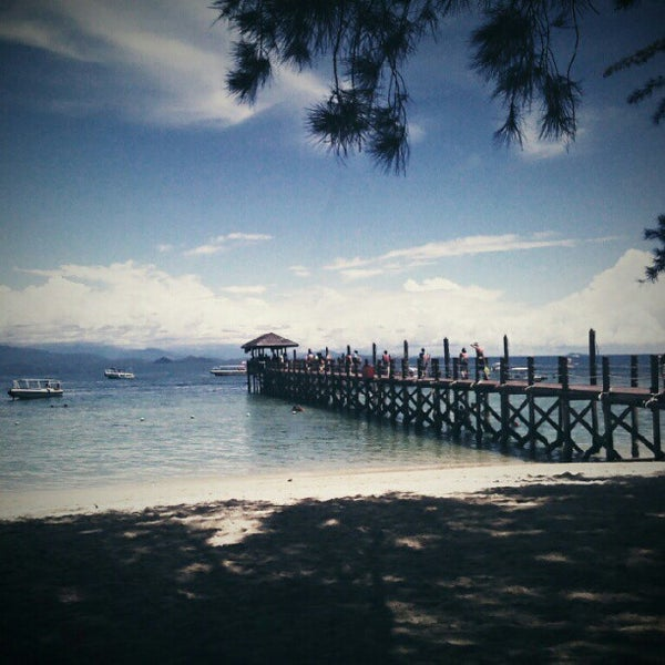 Photo taken at Manukan Island Jetty by Sherrie P. on 7/15/2012