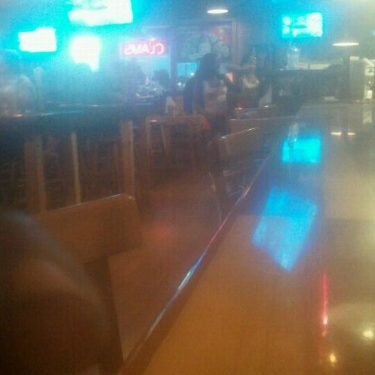 Photo taken at Hooters by Deejay on 6/1/2012