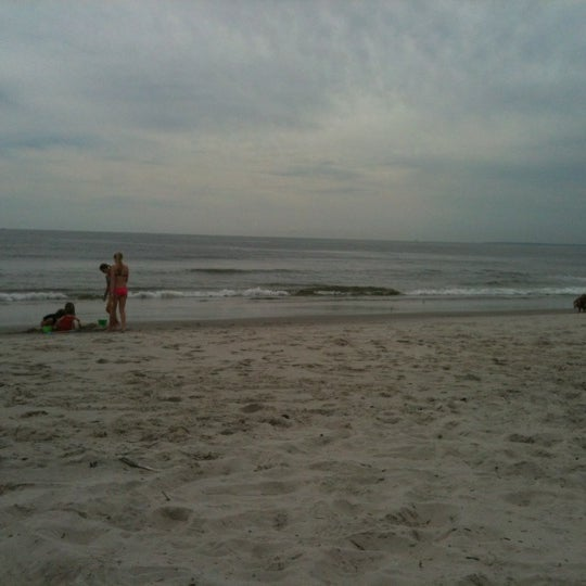 Photo taken at East Atlantic Beach by Anna W. on 8/19/2012