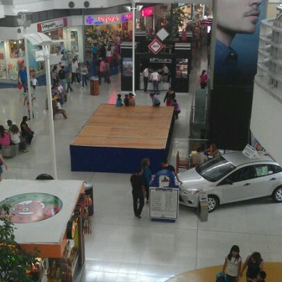 Photo taken at Centro Las Americas by Petit F. on 5/27/2012