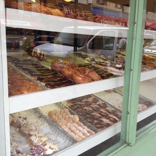 Photo taken at Peter Pan Donut & Pastry Shop by Tonya M. on 7/14/2012