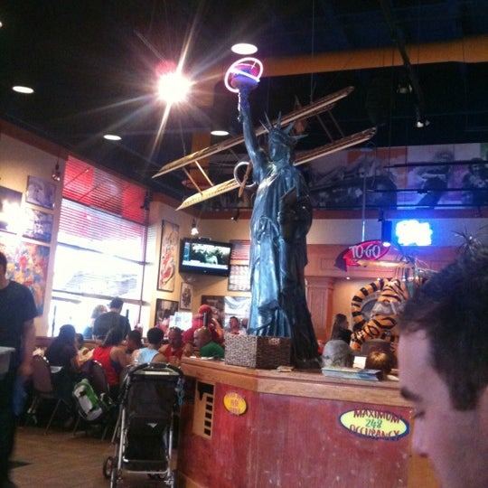 Photo taken at Red Robin Gourmet Burgers by Frank S. on 7/1/2012