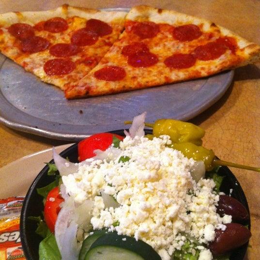 Photo taken at Stone Mountain Pizza Cafe by Tajmiah on 6/22/2012