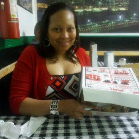 Photo taken at Rosa's Pizza by Tameka J. on 3/14/2012