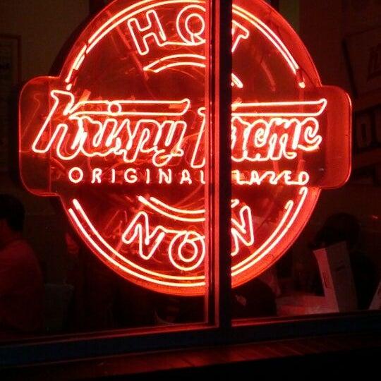 Photo taken at Krispy Kreme Doughnuts by Sara H. on 3/4/2012