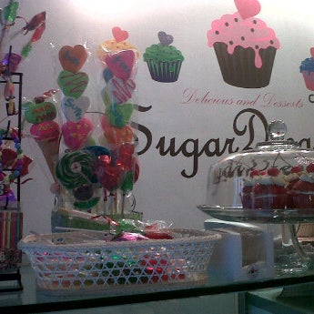 Photo taken at Sugar Blossom by Yanin G. on 5/17/2012