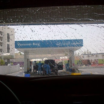 Photo taken at ADNOC by Fatma on 6/23/2012