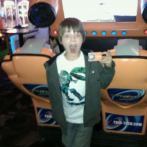 Photo taken at Dave & Buster's by Tess F. on 3/28/2012