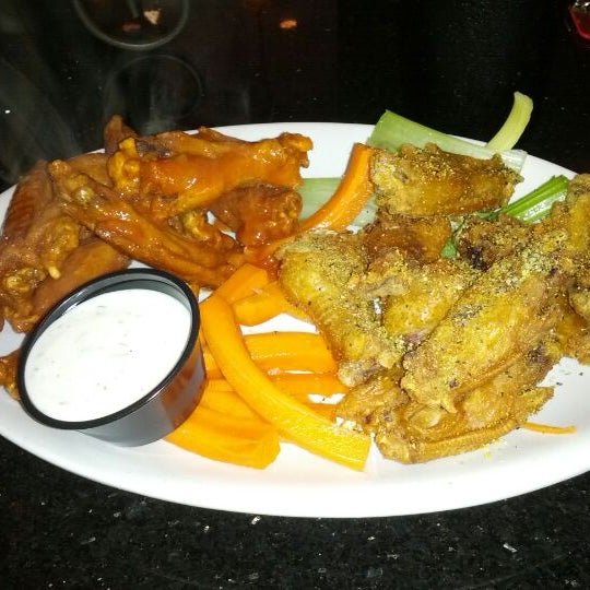 Photo taken at Alondra Hot Wings by Ramon C. on 4/11/2012
