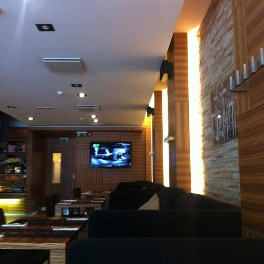 Photo taken at Zebra Café by Yudina A. on 8/22/2012