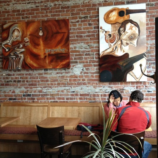 Photo taken at Victrola Cafe and Roastery by DermDoc J. on 6/24/2012