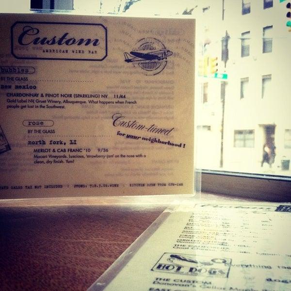 Photo taken at Custom Wine Bar by Christine D. on 7/14/2012